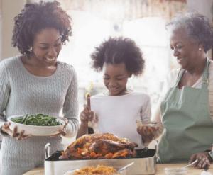Three generations of women prepare food