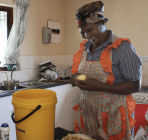 African Woman Smiles in the Kitchen